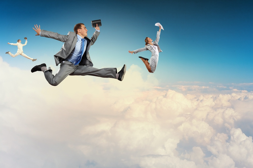 Image of businesspeople jumping high in sky.jpeg